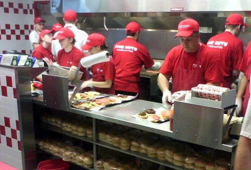 Photo of staff preparing food in a fast food chain